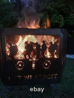Lest We Forget soldier hexagonal fire pit going down of the sun. Black fini